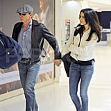 Daniel Craig and Rachel Weisz holding hands.