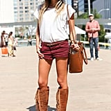 A boho-cool mix we're totally crushing on — fedora, moody Fall cutoffs, and statement boots.