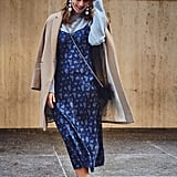 On Fashion Director Hannah Weil McKinley: Baublebar earrings, Alexander Wang sweater, Vince slip dress, H&M coat, Chanel bag, and Miu Miu flats