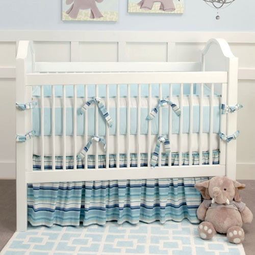 Cool blues look modern on this ocean stripe baby bedding ($60).