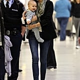 Miranda Kerr and a smiley Flynn Bloom touched down in Sydney in July 2011.