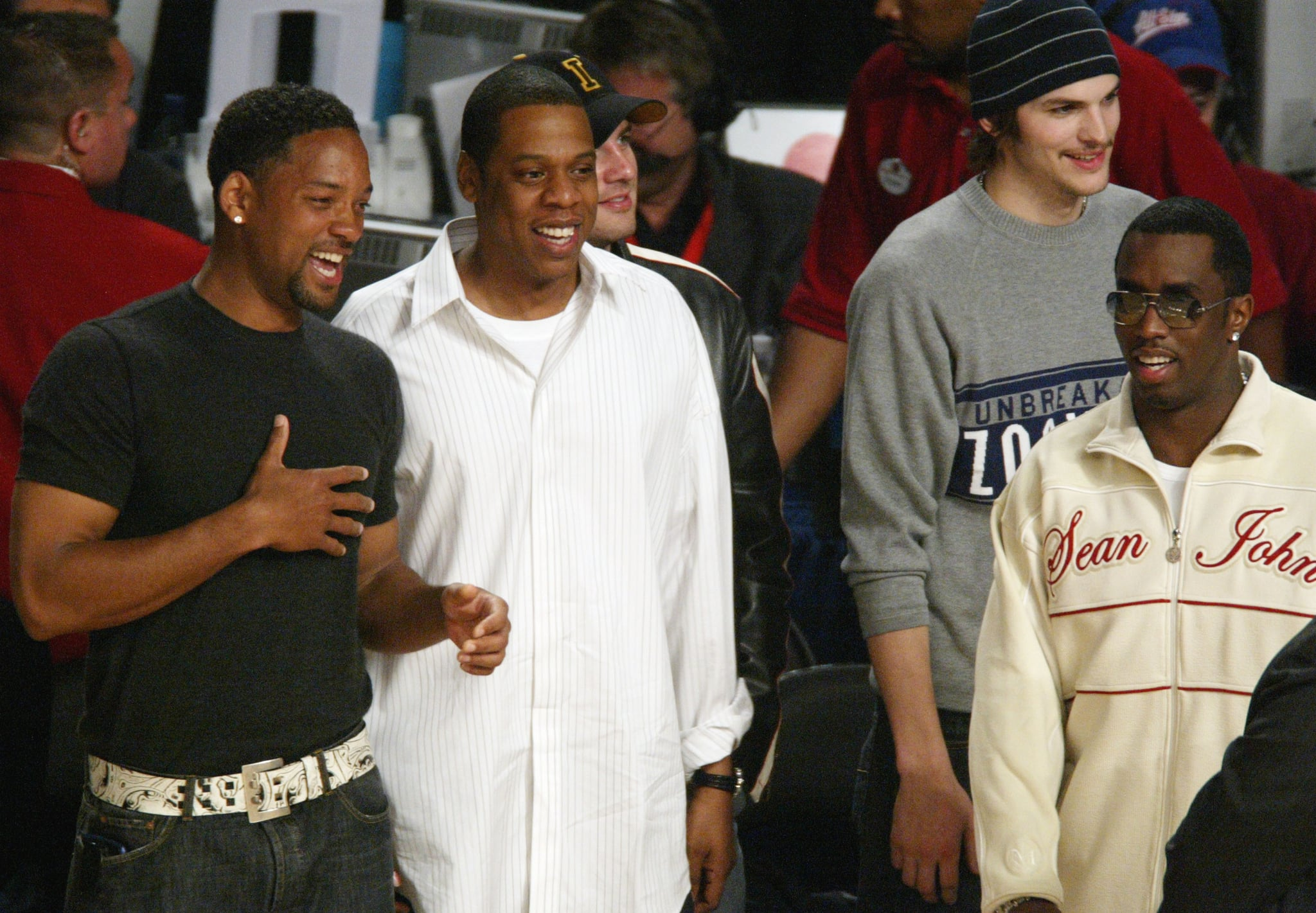 Will Smith shared a laugh with Jay Z, Diddy, and Ashton Kutcher at a game in February 2004.
