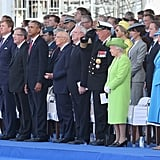 The queen stands out as much shorter than other notable figures like Former President Barack Obama.