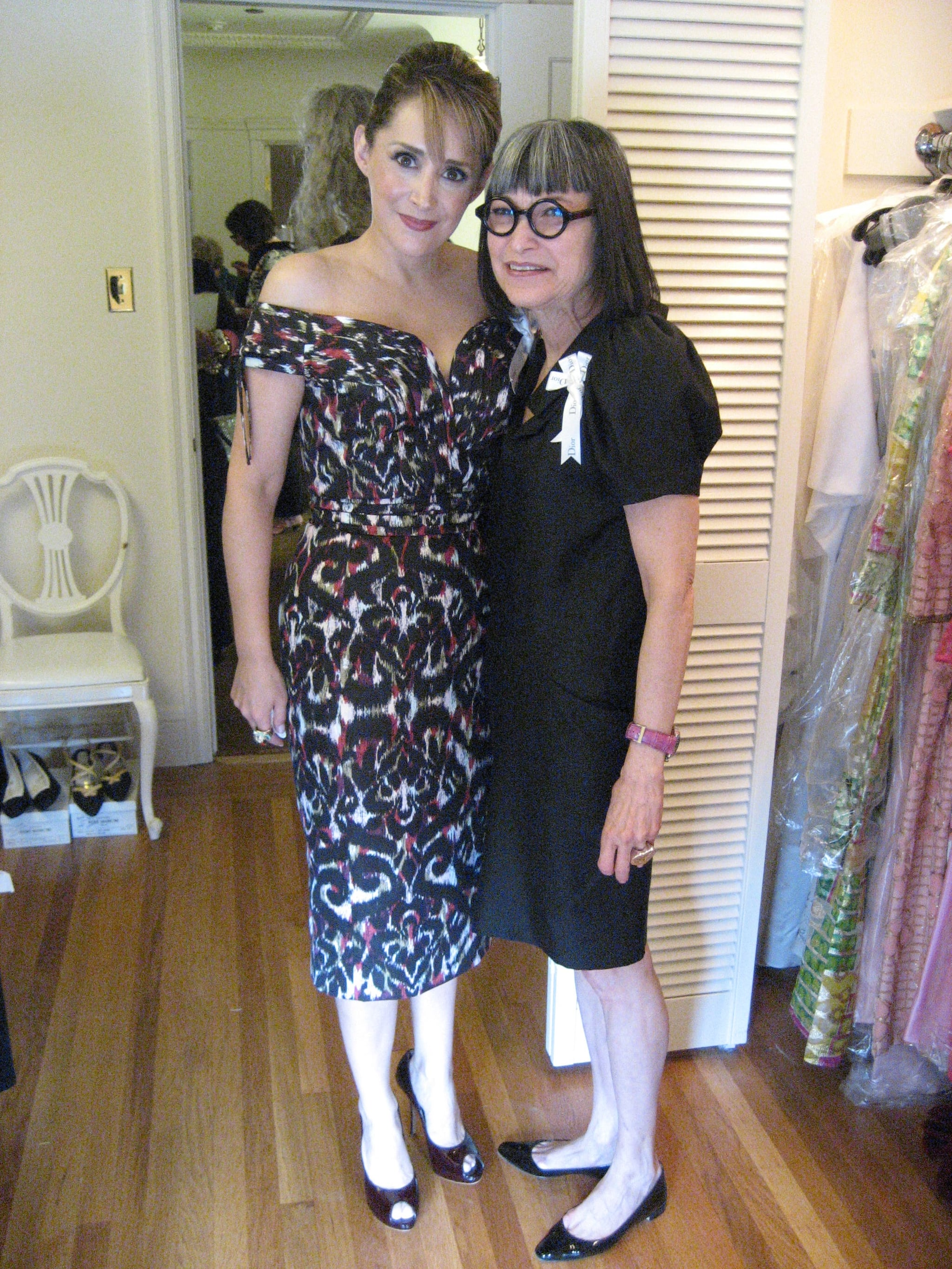 Two fashionable volunteers in the '20s room.