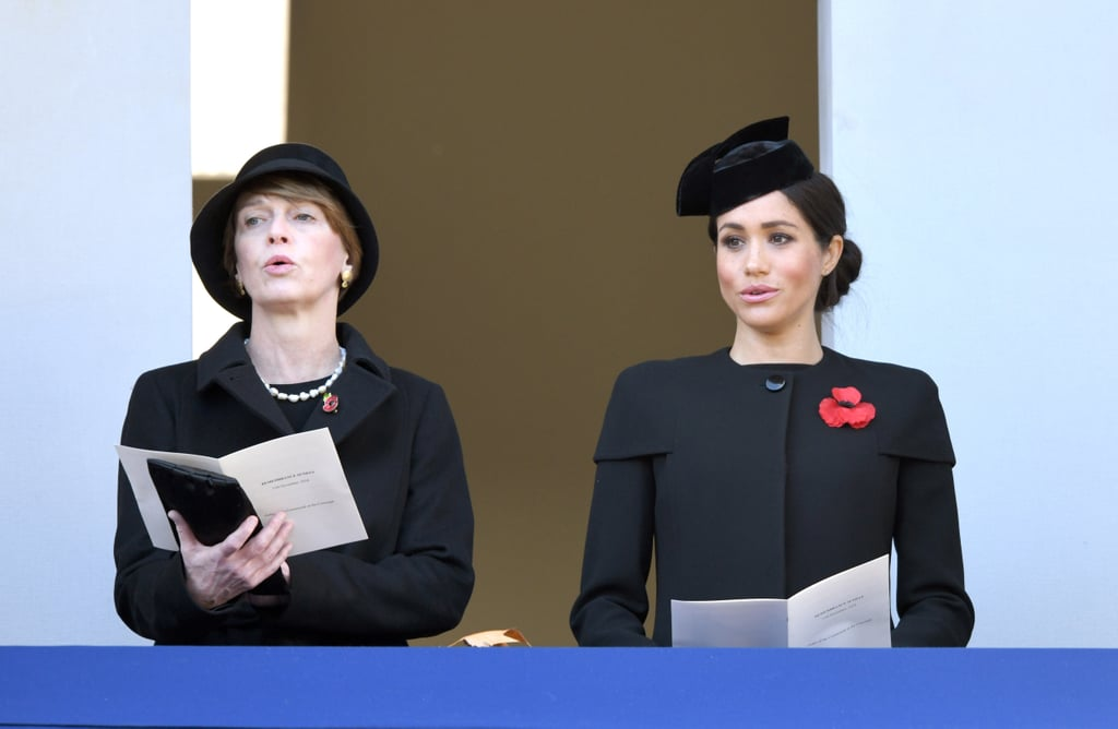 Following a night at the Royal British Legion Festival of Remembrance, Meghan Markle, Prince Harry, Kate Middleton, and Prince William reunited once again to honor those who have suffered and died at war during the annual Remembrance Sunday service in London on Nov. 11. This marks the first Remembrance Day service for Meghan, who did not attend as Harry's girlfriend last year.  During the service, Harry and William laid wreaths at The Cenotaph, while Queen Elizabeth II, Kate, and Camilla Parker Bowles watched from a balcony. Meghan viewed the proceedings from a separate balcony with German President Frank-Walter Steinmeier's wife Elke Budenbender. Despite reports that the Fab Four are distancing from each other, this separation is likely less of a slight, and more of a dedication to the traditional pecking order. See more photos from the royals' appearance below.       Related:                                                                                                           Meghan Markle's Mom, Doria Ragland, Will Not Spend Christmas With the Royals