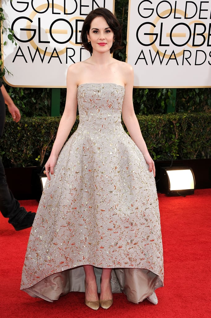 Michelle Dockery looked as elegant as ever in Oscar de la Renta on Sunday when she arrived at the 2014 Golden Globes in LA. The British actress is at the bash to support her hit TV show, Downton Abbey, which is nominated for best TV series, drama, against Breaking Bad, The Good Wife, House of Cards, and Masters of Sex. Michelle's fans may have to choose between seeing her at the Globes and watching her act on the small screen as her show will be a airing on PBS during the Globes in its usual 9 p.m. slot on PBS. Keep reading to see more of Michelle from the Golden Globes red carpet.