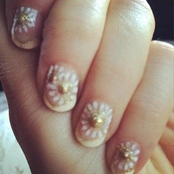 Known for her nail art, Zooey Deschanel sported these dainty daisies. Source: Instagram user zooeydeschanel