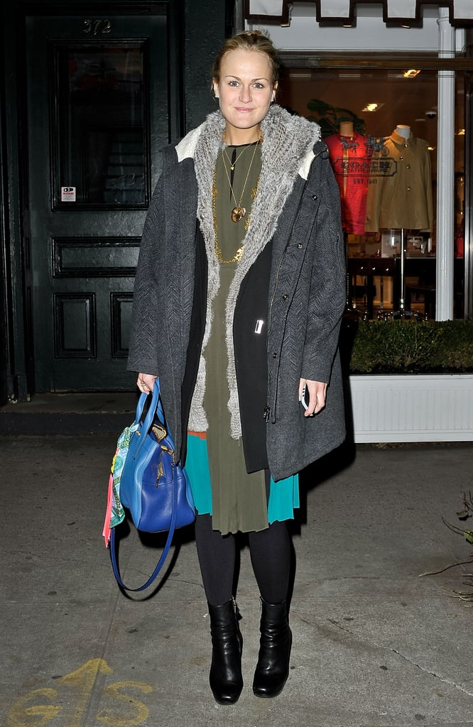 Teen Vogue's Mary Kate Steinmiller winterized a silky little dress with layers of cozy outerwear, black boots, and tights to anchor the look.