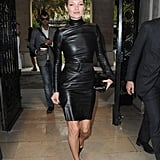 Kate wears a black leather dress to Miu Miu's Spring/Summer 2010 show in Paris.
