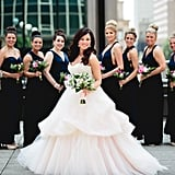 Each of these bridesmaids sported different styles of navy blue dresses.