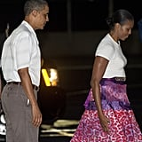 Michelle wearing a leopard-print silk skirt with a white tee leaving Honolulu.