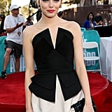 Emma Stone wore a black and white mini dress at the MTV Movie Awards.