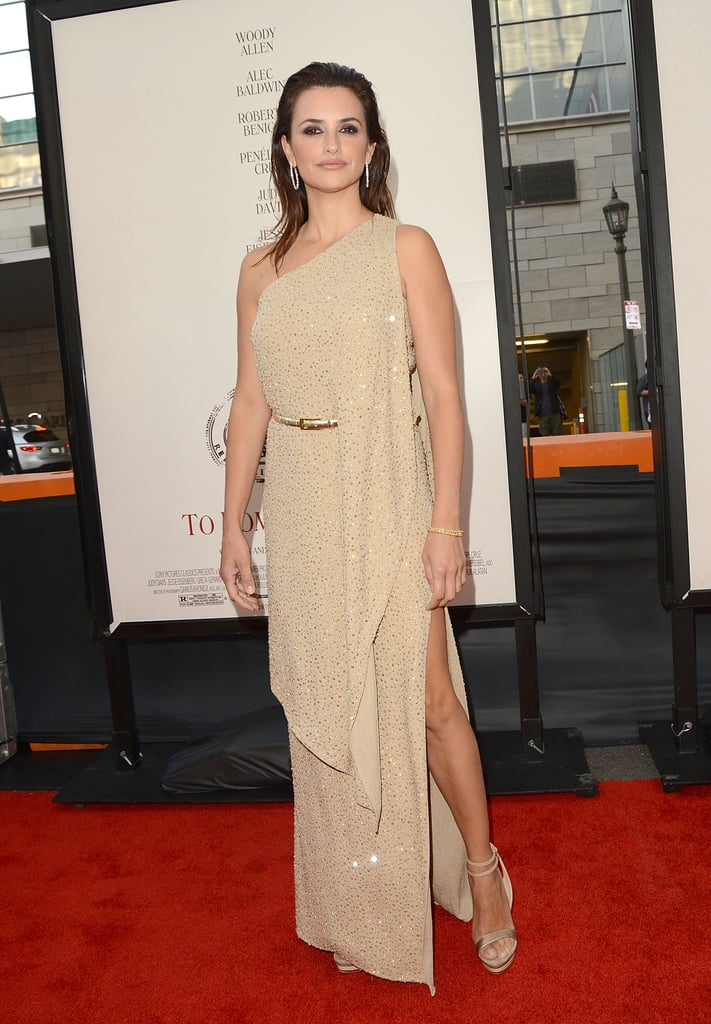 Penelope Cruz showed off her sexy legs under a slit in her Michael Kors gown at the premiere of To Rome With Love in LA.