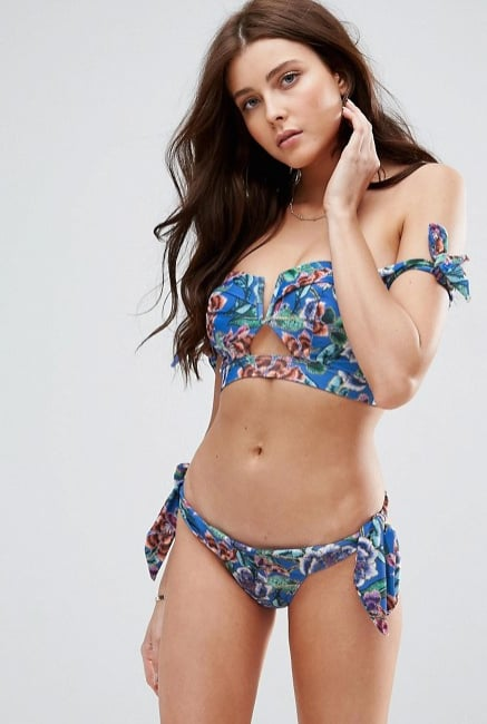 If you're fuller-busted and need a little more support, there's still a way to make this look work. Choose styles with bardot straps, rather than frilled panels, like this ASOS design created specifically for DD+ cup sizes (£18). The ties on the matching briefs (£14) continue the theme and also give you a little leeway when it comes to size!