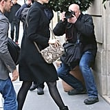Anne looked impeccably chic in all black as she headed into the Lanvin boutique in Paris. She added a much-needed pop of print to her ensemble via her python-print Stella McCartney crossbody bag ($1,200).