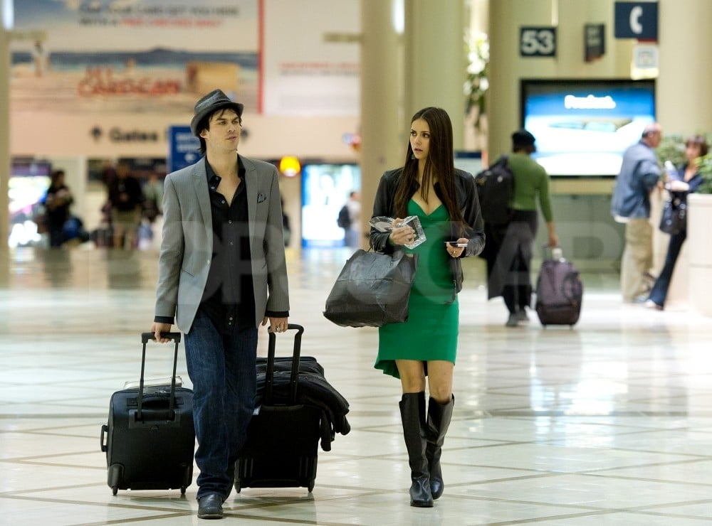 Ian Somerhalder carried both bags through LAX after the People's Choice Awards with Nina Dobrev.