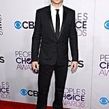 Ian Somerhalder wore a black suit.