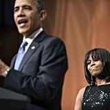 The president spoke at the inaugural reception while Michelle Obama looked on.