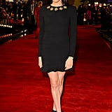 When she attended the 2013 UK premiere of The Hunger Games, Meghan proved that a little black dress definitely doesn't have to be boring. For the occasion, she wore an embellished Alexander McQueen dress, which she accessorized with ribbon heels.