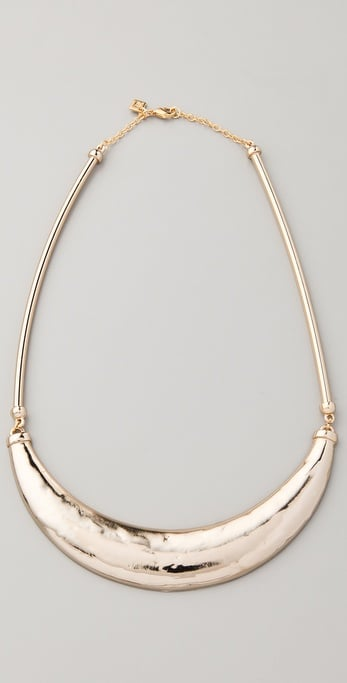 It's simple enough, but this understated little gem will pop against even your plain black tee.  Belle Noel Molten Gold Signature Necklace ($125)