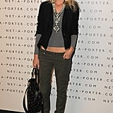Poppy Delevigne goes casual in the Layne Cargo by Paige Denim and shows off some midriff. Her whole mix plays with proportions with utmost ease.