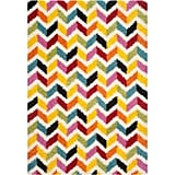"""From the chevron pattern to the vivid tones, the Safavieh Marcelyn Power-Loomed Shag Area Rug ($34-$122) screams """"bold"""" on all fronts."""