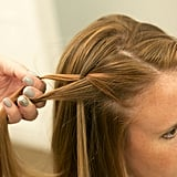 Drop the section of hair you just placed so it falls through your twist, creating that waterfall effect.