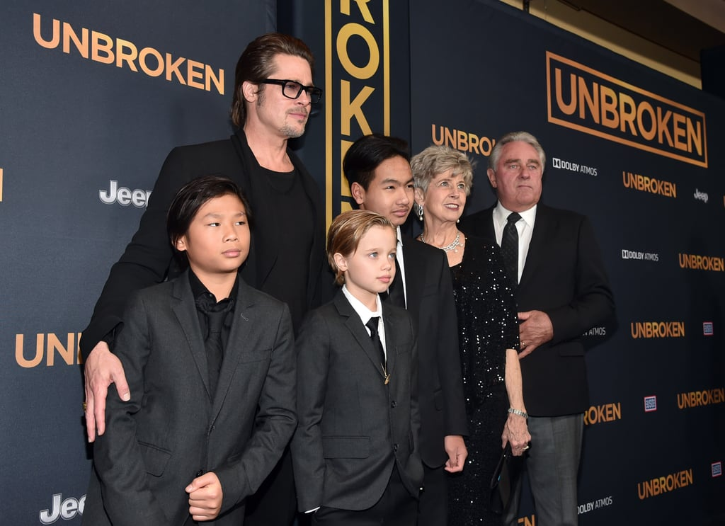 "Although Angelina Jolie may have the chicken pox, Brad Pitt and their kids made sure to show their support for her new film, Unbroken, by stepping out for the film's LA premiere on Monday. Brad and his parents posed for pictures with Maddox, Pax and Shiloh, who all suited up for the occasion. Last week, Angelina made a point to explain why she'd be missing the events this week, saying, ""I will be at home itching and missing everyone, and I can't believe it because this film means so much to me,"" adding, ""You have to laugh at the timing."" Take a look at the family's sweet snaps from the Unbroken premiere."