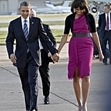 Michelle Obama and the president arrived hand in hand in Dallas in April. Michelle opted for a bright, belted sheath dress by Roksanda Ilincic and classic pumps.