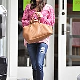 Jordana Brewster's pink printed tunic melded beautifully with her denim and tan bag.