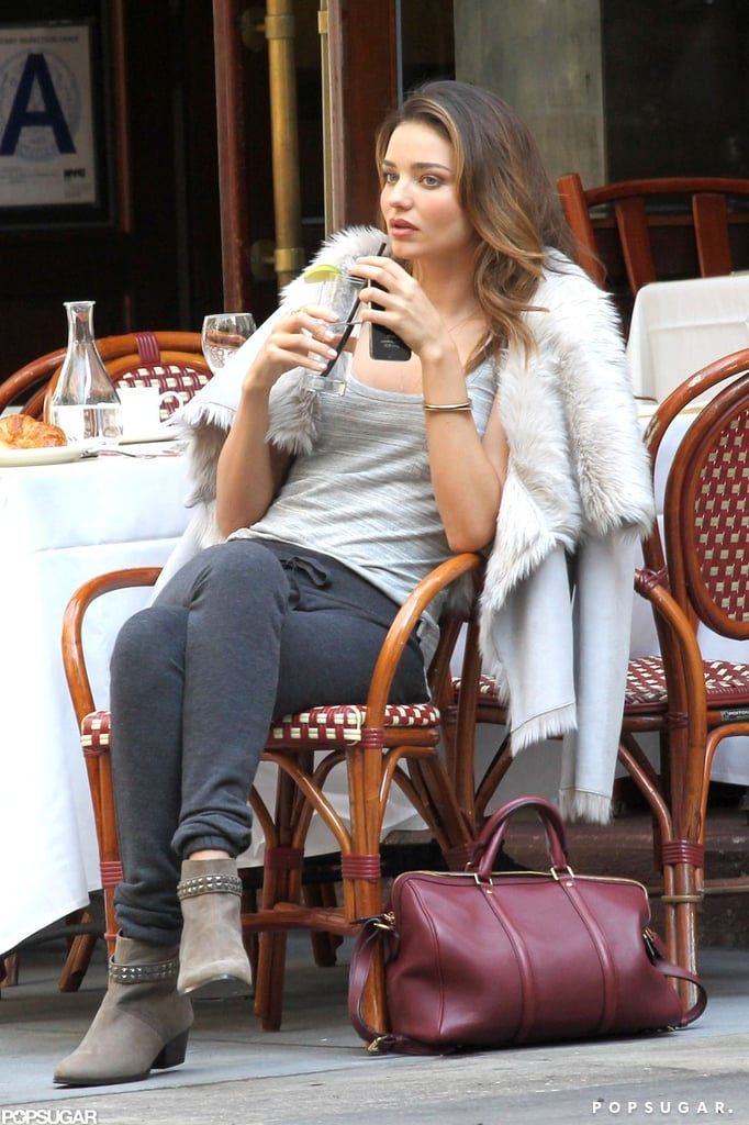 Miranda Kerr sipped a drink while shooting a Victoria's Secret campaign.