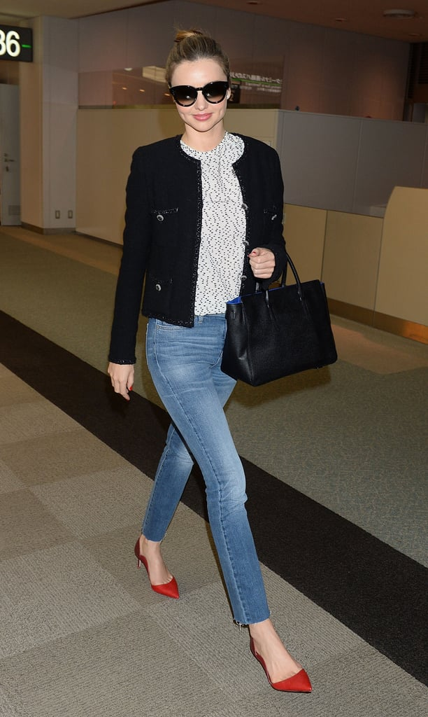 Everyone knows that a crisp, tailored jacket paired with a subtle, black-and-white print is instantly elevated with a pop of red. But, we love how Miranda adds an element of surprise with the raggedy hem of her jeans.