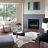 It was as simple as unscrewing the birch legs and screwing in the darker ones. Really! The end result?  A couch that perfectly complements the rest of their striking living room.