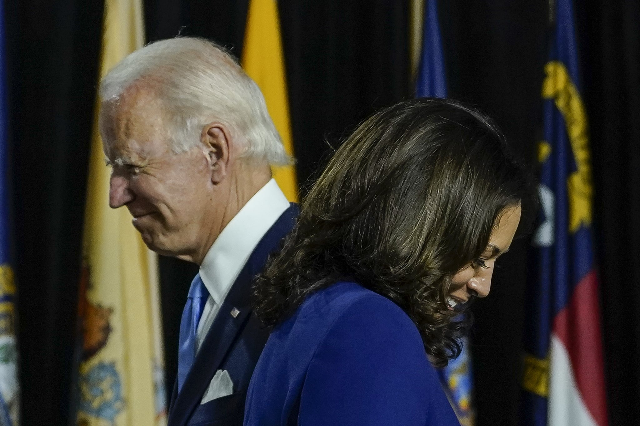 WILMINGTON, DE - AUGUST 12: Presumptive Democratic presidential nominee former Vice President Joe Biden invites his running mate Sen. Kamala Harris (D-CA) to the stage to deliver remarks at the Alexis Dupont High School on August 12, 2020 in Wilmington, Delaware. Harris is the first Black woman and first person of Indian descent to be a presumptive nominee on a presidential ticket by a major party in U.S. history. (Photo by Drew Angerer/Getty Images)