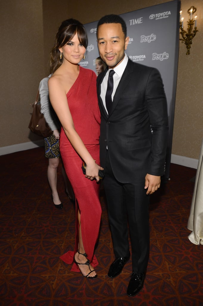 John Legend and Chrissy Teigen showed PDA at the People and Time bash.