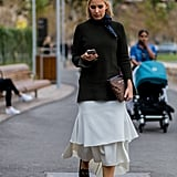 And Incredibly Stylish With a Midi Dress and Black Jumper