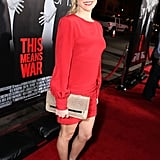 Kristin Cavallari's snake-print clutch paired perfectly with an eye-catching red mini.