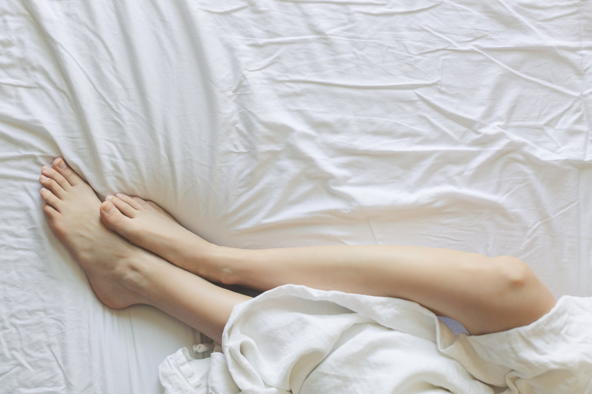 The STIs That Condoms Can't Completely Protect You From, According to an Ob-Gyn