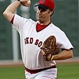 Will Ferrell was in full Boston Red Sox gear to throw a pitch in July 2006.
