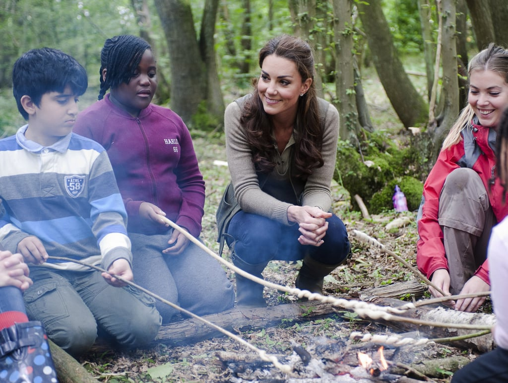 Kate Middleton dressed down in Zara jeans, Le Chameau wellies, and Burberry top, for an adventurous day at Expanding Horizons' primary school camp in Wrotham, Kent, UK, today. She joined a group of children for various outdoor activities including making fires and creating shelters out of canvas. The charity event is organized by ARK Schools, which is supported by The Foundation of Prince William and Prince Harry. A June 2011 fund-raising gala for the ARK organization was actually Kate and William's first public appearance since getting married.  It's been a busy few days for Kate, who joined the royal family for the Trooping the Colour ceremony in London yesterday and also hosted youth at a play in Kensington Gardens on Friday.