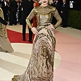 Rachel's Valentino Met Gala dress was embroidered with gold thread and helped her achieve feminine edge.