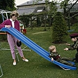 The young brothers played together on a slide in the garden of Highgrove House with their mother, Diana, in July 1986.