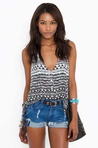 This tribal-print tank has just the right dose of bohemian-cool to add to a pair of cutoffs or a bold-hued skirt.  Nasty Gal Button Up Tribal Tank ($30)