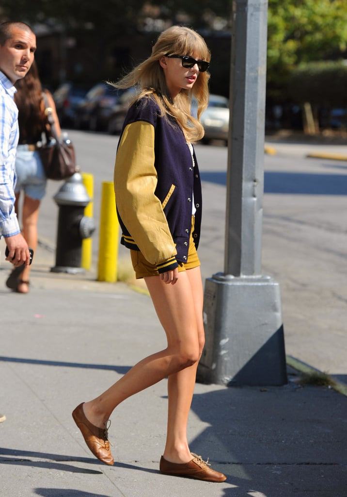 Taylor Swift sported a letterman jacket and shorts in NYC.