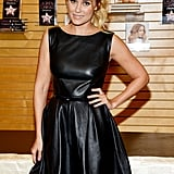 Lauren Conrad wore a black leather dress for her book tour in LA.