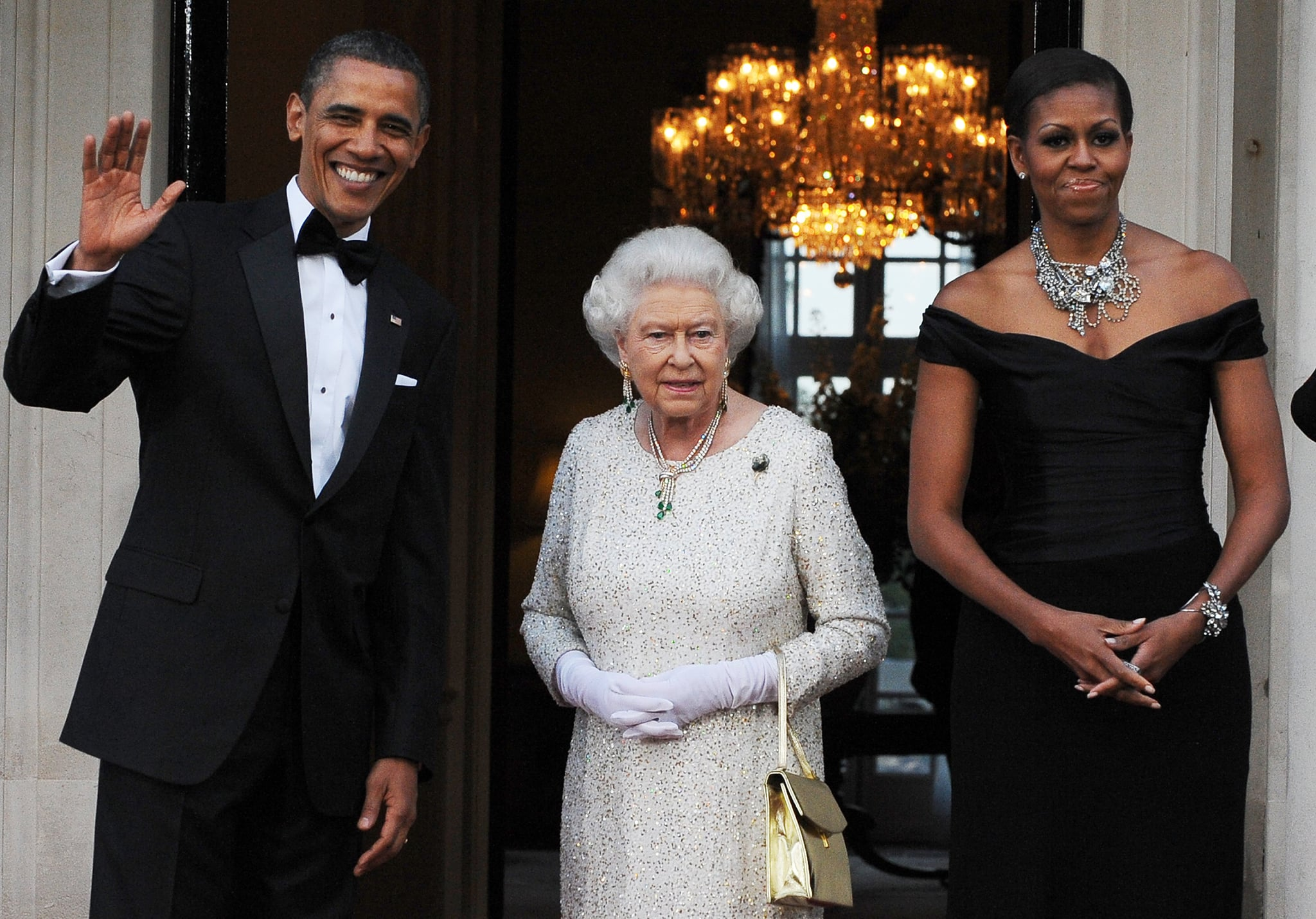 US President Barack Obama (L) and First Lady Michelle Obama (R) greet Britain's Queen Elizabeth II before a reciprocal dinner at the Winfield House in London, on May 25, 2011. Obama and his wife Michelle enjoyed a regal welcome from Queen Elizabeth II, who has met every US president but one since the 1950s. Obama's visit, the second stop on a European tour, comes as Britain seeks to prove its staying power despite fading military might and Washington looks to retool its decades-old alliance with Europe as a catalyst for global action. AFP Photo/Jewel Samad (Photo credit should read JEWEL SAMAD/AFP/Getty Images)