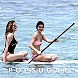 Kendall and Khloé went paddleboarding.