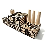 "Traditional building blocks ($70) don't have to scream ""baby"" — this Alphabet Factory set features hip typography and fun black and white patterns."