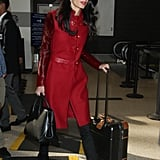 Opting For a Bold Red Coat With Thigh-High Boots