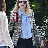 Emma Stone wore a blue collared shirt and printed jacket in LA.